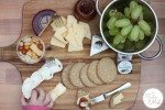 Cheese Platter with Fruit, Chutney & Savoury Digestive Biscuits... and a little hand!