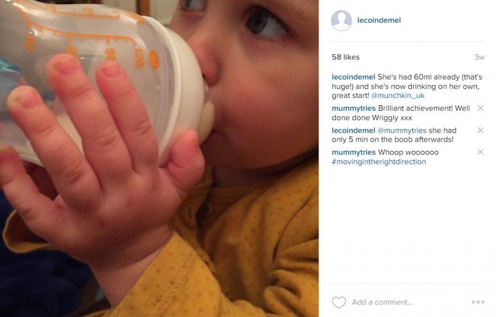 Drinking her milk on her own - LATCH bottlle