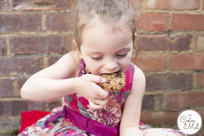 Child eating vegan oatmeal cookies