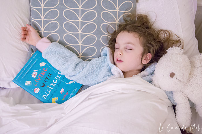 This is a photo of my little girl on the day we received Emma's book. She's fallen asleep with the book! Click for a review of Living with Allergies: Practical Tips for All the Family by Emma Amoscato, which answers questions like Why are allergies on the rise?