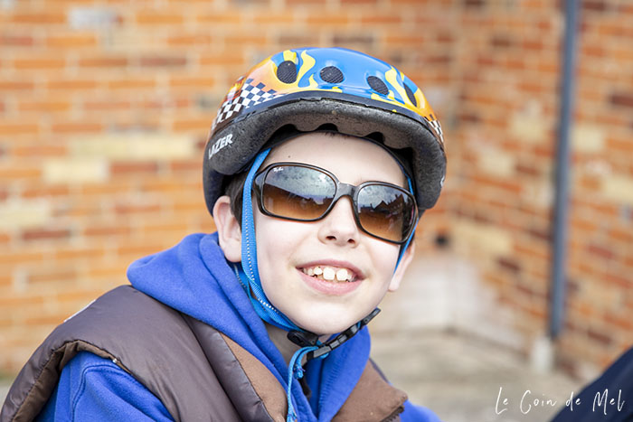 My eldest, about to go cycling. He is wearing a blue helmet, a blue jumper and my Ray-Ban RB4068 sunglasses.