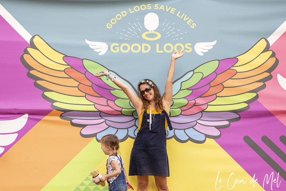 My youngest girl and I. I am posing in front of large colourful wings. I am wearing my Ray-Ban RB4068 sunglasses.