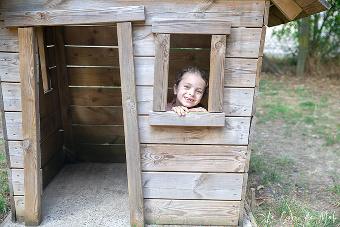 Jumpy in a small wooden house in the playground at La Ferme Souchinet
