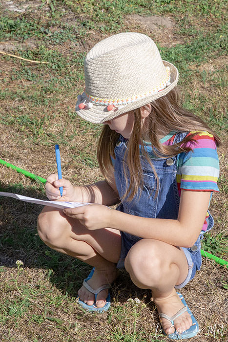 Beanie ticking things off her Nature Scavenger Hunt list