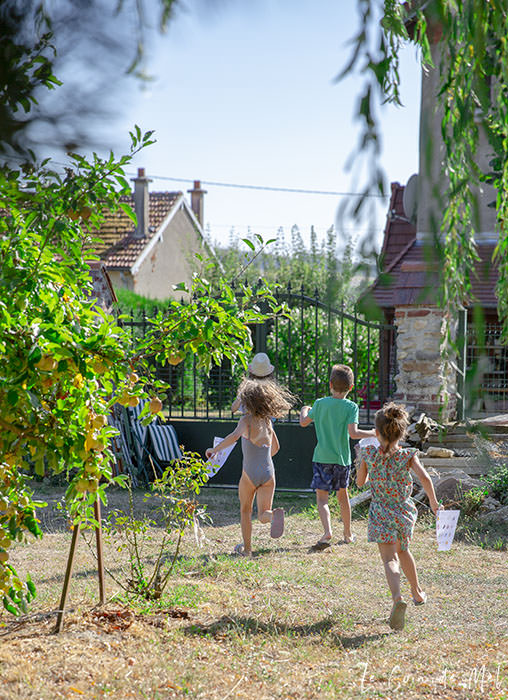 Children running excitedly as they go on a Nature Scavenger Hunt