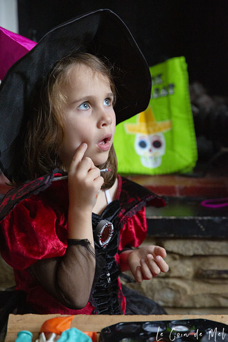 My youngest girl, dressed as a witch and lost in thought, just before our Halloween Treasure Hunt