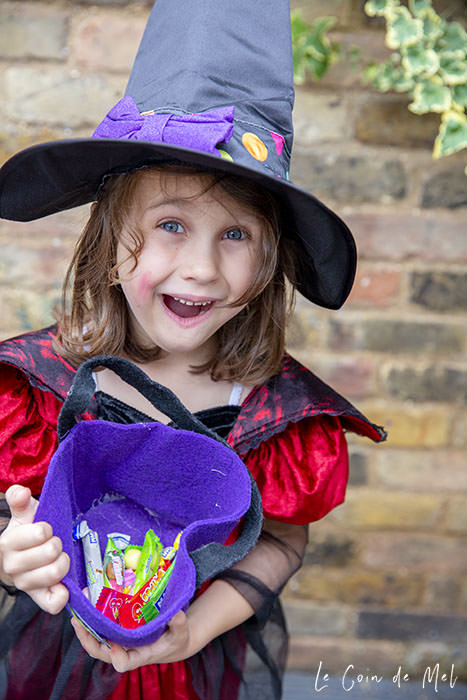 My youngest daughter, dressed as a witch showing off her loot after our Halloween Treasure Hunt
