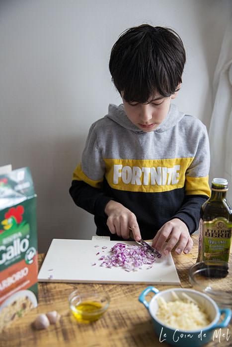 My boy chopping onions finely