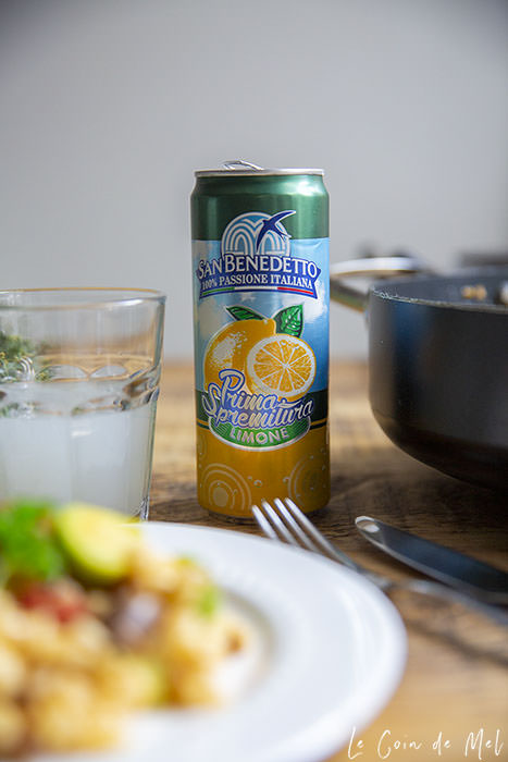 San Benedetto Lemonade can in focus, Easy Chorizo Risotto with Chestnuts and Brussel Sprouts out of focus