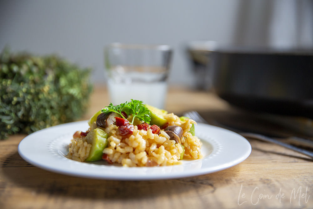 This is a picture of the finished Easy Chorizo Risotto with Chestnuts and Brussel Sprouts, with a glass of lemonade in the background